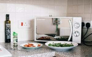 Microwave oven sitting on a kitchen benchtop